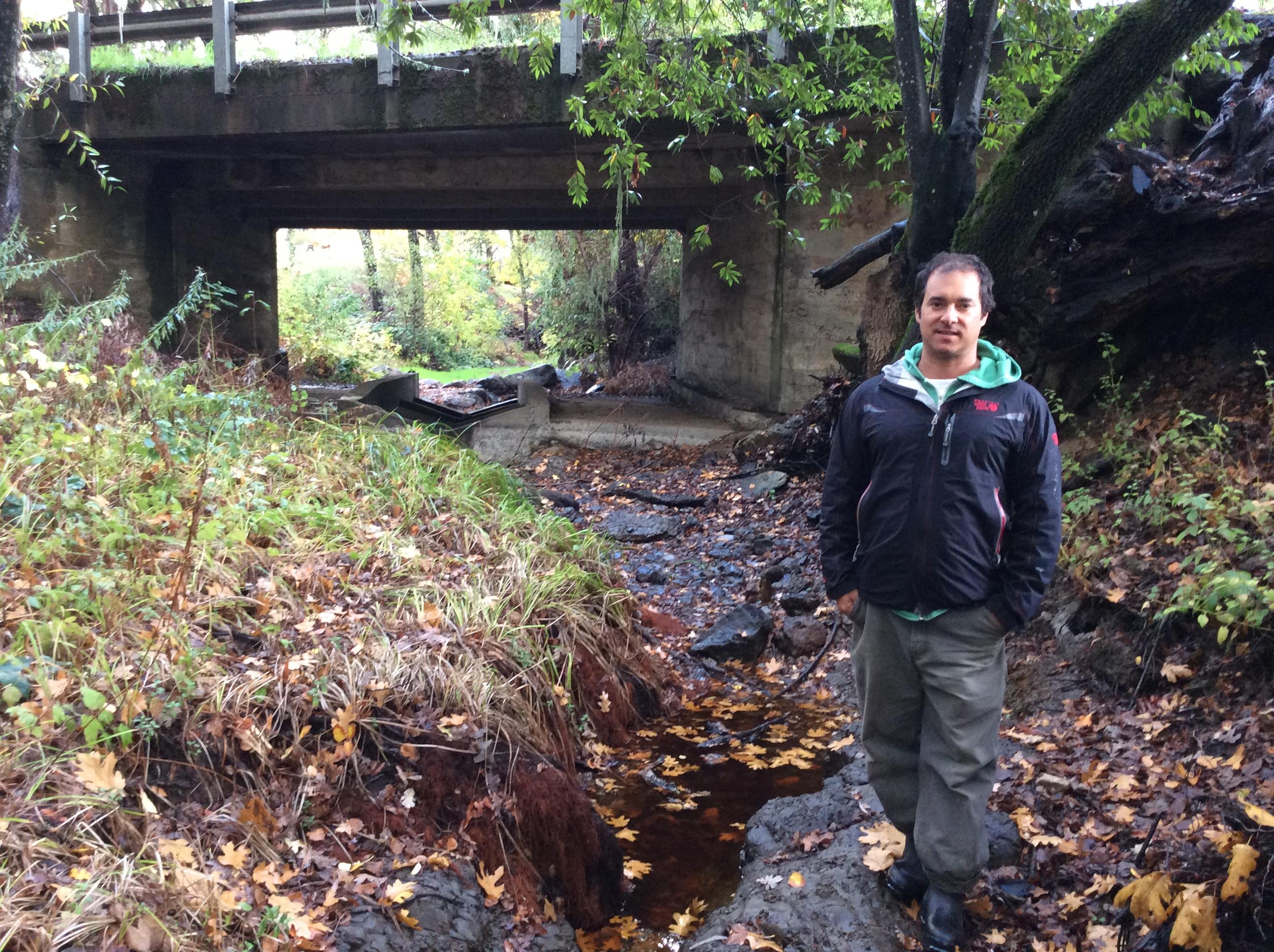 Martorana Family Winery winemaker Gio Martorana standing in the creek he helped restore.